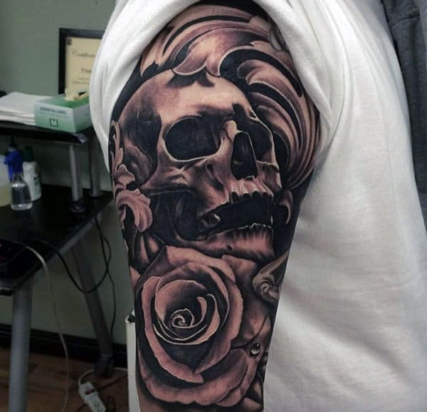 Male Black Ink Skull And Rose Flower Sleeve Tattoo