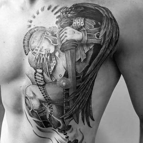Male Chest Aztec Warrior In Curtsey Tattoo