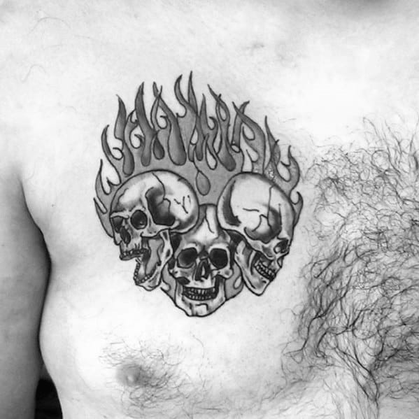 Male Cool Flaming Skulls Upper Chest Tattoo Ideas