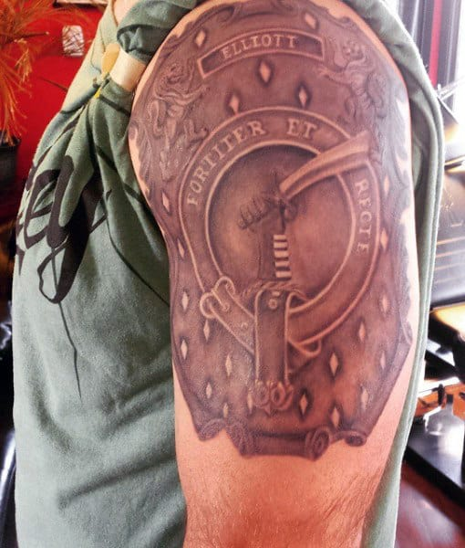 Male Family Crest Tattoo With Hand Waving Sword