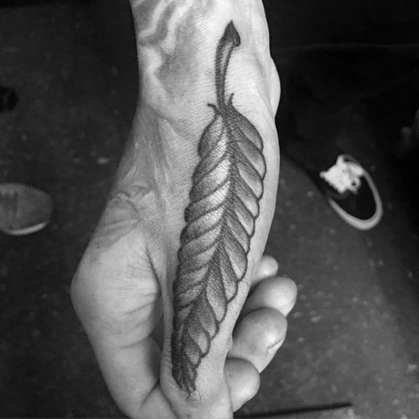 Male Feather Thumb Tattoos