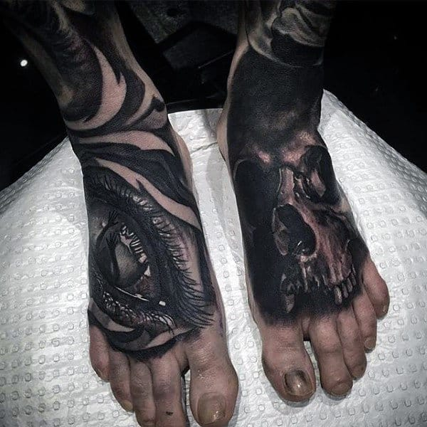 Male Feet Interesting Tattoo Of Eye And Skull