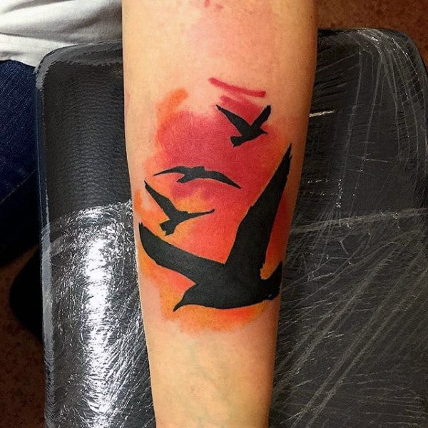 Male Flying Bird Sihouette Calf Sunset Tattoo