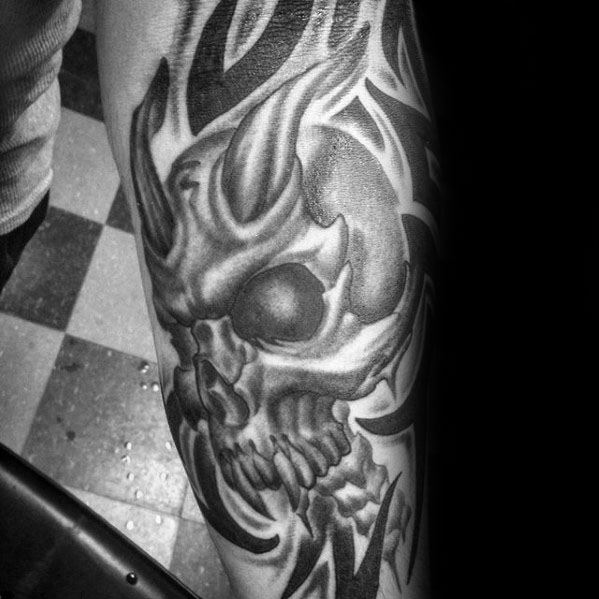 Male Forearm Sleeve Tribal Skull Tattoo Design Inspiration