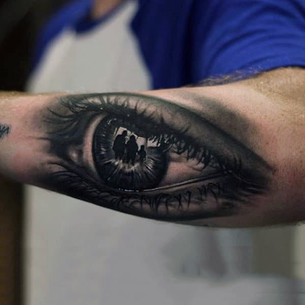 Male Forearm Three People Inside Eye Ball Tattoo