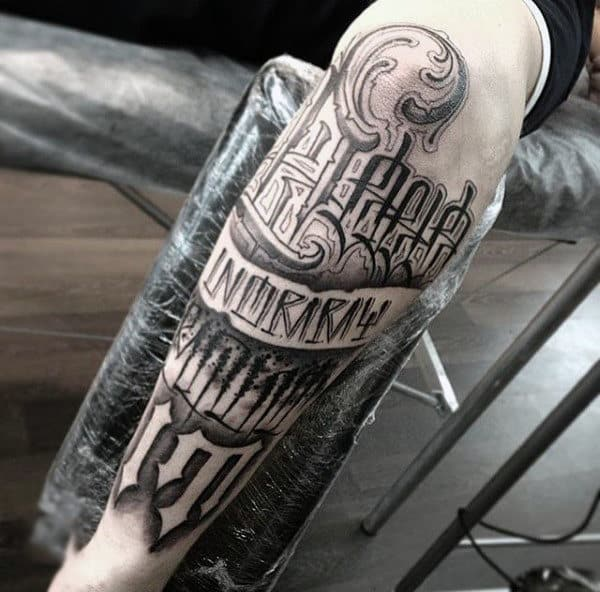 Male Forearms Celtic Lettering Tattoo