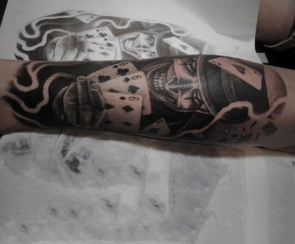Male Forearms Gleeing Man With Playing Cards Tattooo