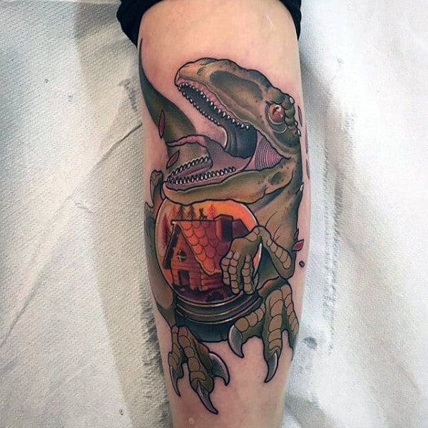 Male Forearms Green Dinosaur With Orange Sphere Tattoo