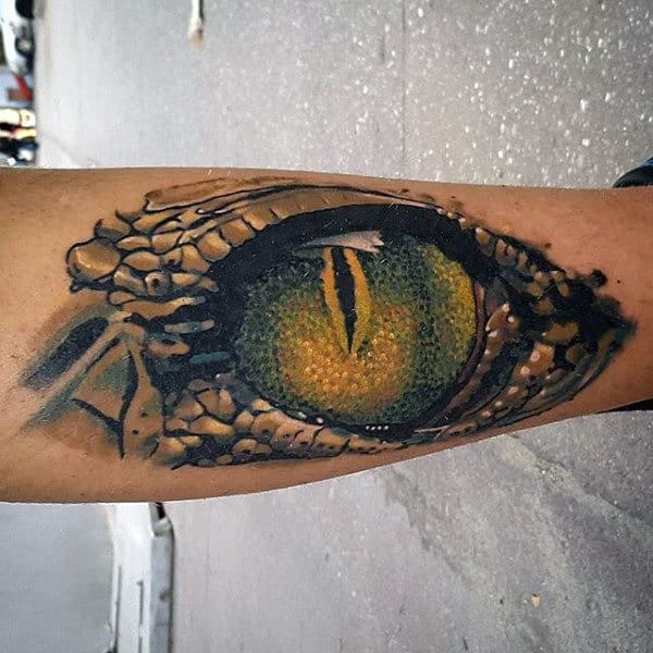 Male Forearms Green Shaded Eye Tattoo With Reptile Skin Background