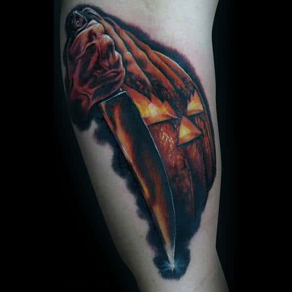 Male Forearms Halloween Pumpkin With Gleaming Sword Tattoo