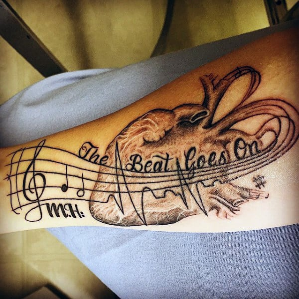 Male Forearms Musical Heartbeat And Anatomical Heart Tattoo