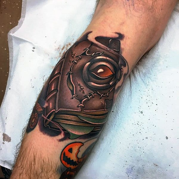 Male Forearms Mystical Book With Metallic Amber Eye On Cover Tattoo