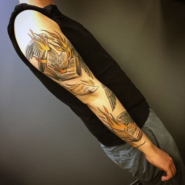 Male Full Sleeves Burning Books And Pages Flying Tattoo