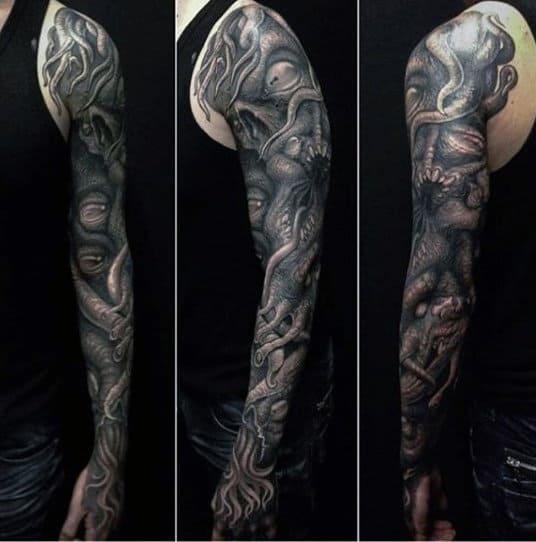 Male Full Sleeves Heavy Detailing Black Eyes Tattoo