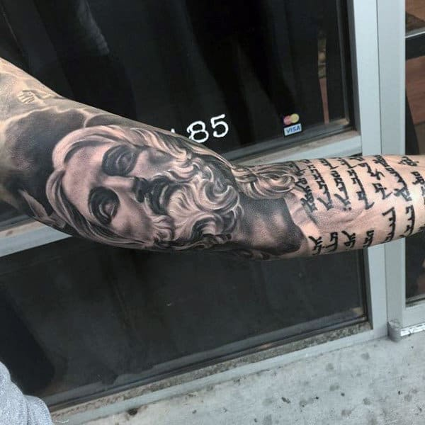 Male Full Sleeves Interesting Scripted Religious Tattoo Ideas