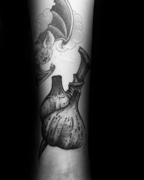 Male Garlic Themed Tattoos