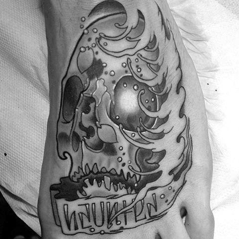 Male Grayish Graphic Tattoo On Foot