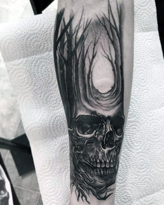 Male Great Tattoo With Skull And Row Of Trees Design On Inner Forearm