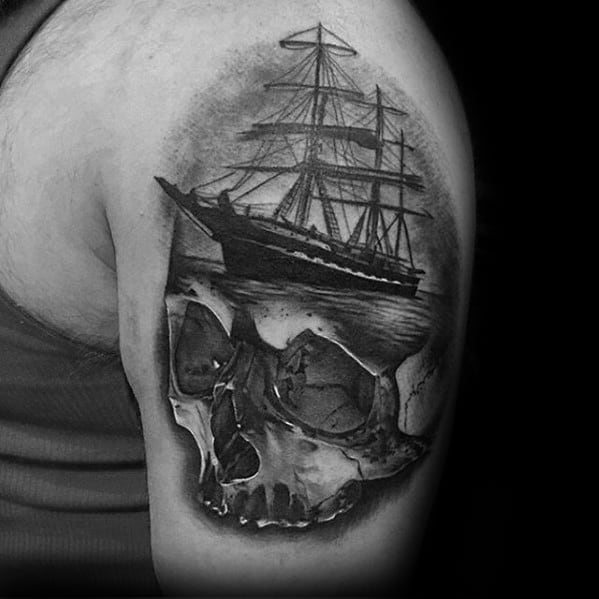 Male Greatest Skull And Ship Tattoo Ideas On Upper Arm