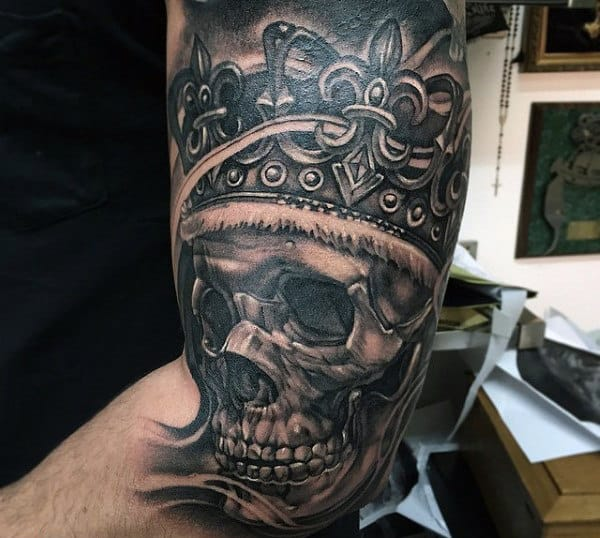 Male Grey Skull With Aristrocratic Crown Tattoo Biceps