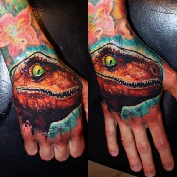 Male Hands Green Eyed Brown Dinosaur Tattoo