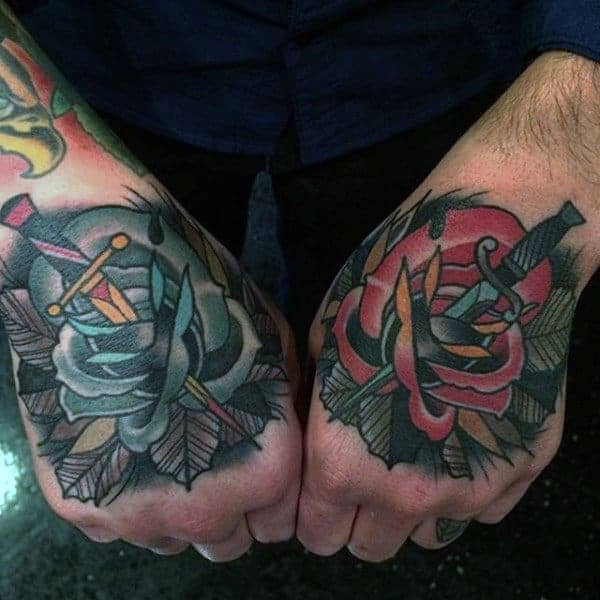 male-hands-knife-and-rose-tattoo