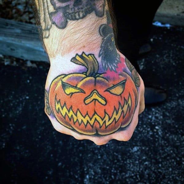 Male Hands Orange Halloween Pumpkin Tattoo