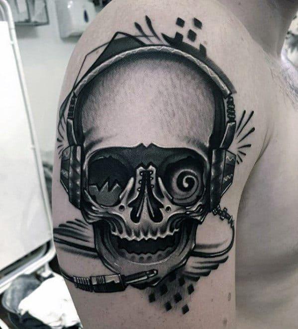 Male Headphones Tattoo Ideas With Skull Design On Arm