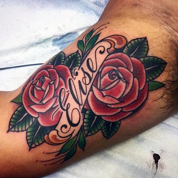 Male Inner Biceps Pair Of Red Roses Tattoo
