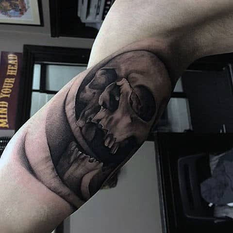 Male Inner Biceps Skull Tattoo