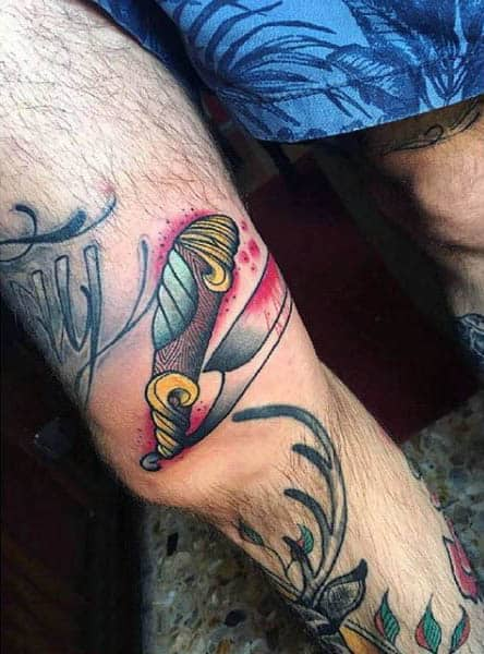 Male Knees Bloody Neo Traditional Weapon Tattoo