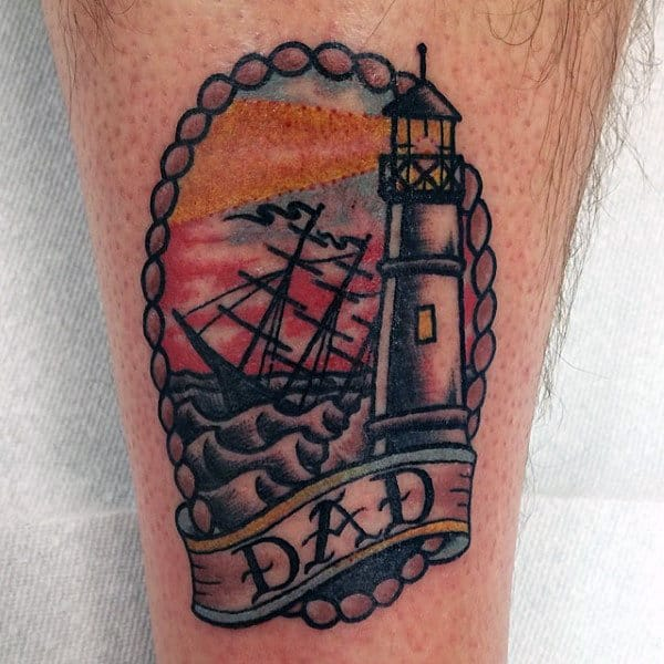 Male Legs Lighthouse And Dad Tattoo