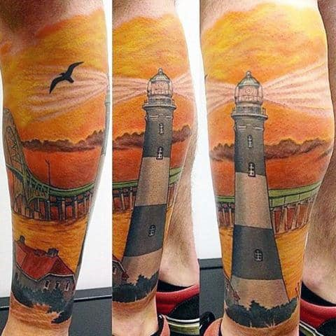 Male Lighthouse At Sunset Tattoo On Calf Brightly Colored
