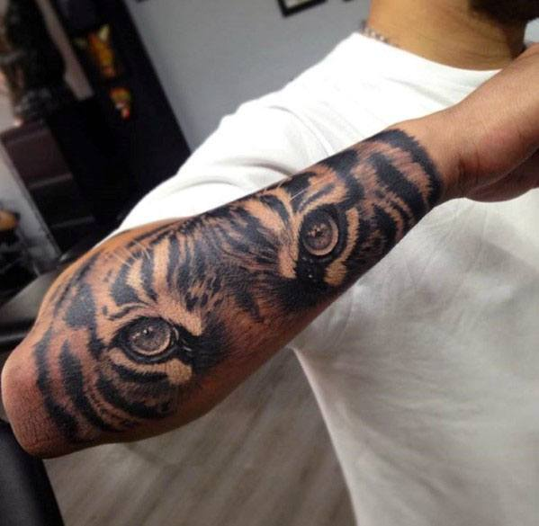Male Outer Forearm Tiger Eyes Tattoo Design Inspiration