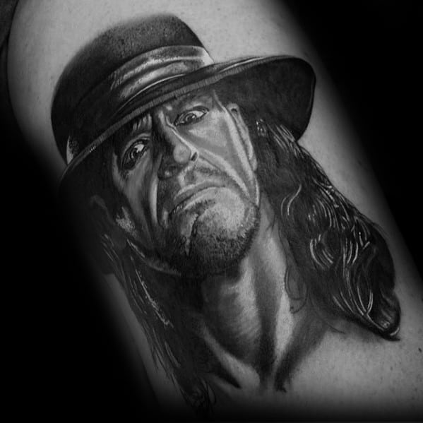Male Portrait Tattoo With Wrestling Design On Arm