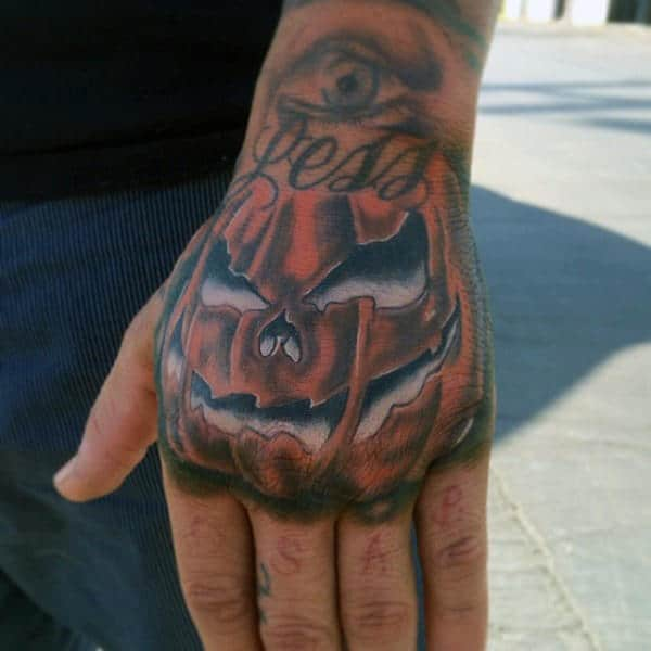 Male Pumpkin Hand Tattoo With White Ink