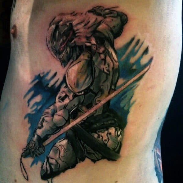 Male Rib Cage Side Watercolor Video Game Metal Gear Tattoo Ideas