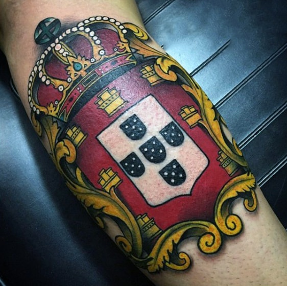 Male Royal Family Crest Tattoo On Bicep With Crown