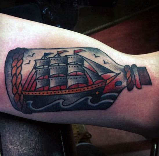 Male Sailing Vessel Tattoos In A Bottle On Bicep