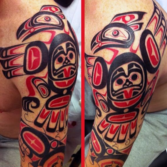 Male Shoulders Dark Red Black Haida Tatto