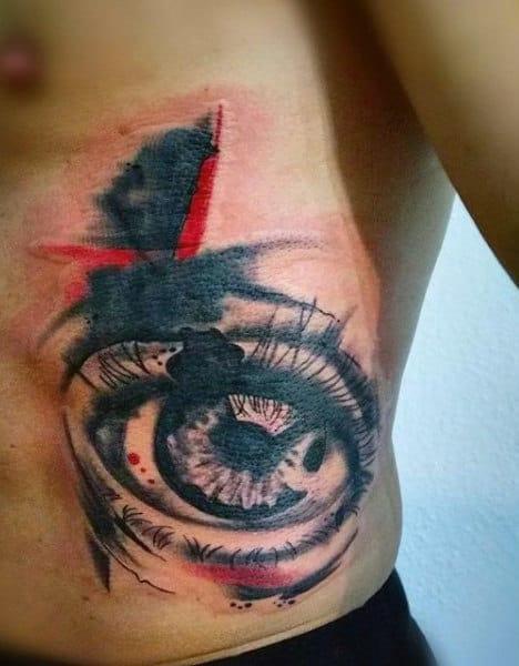Male Side Ribs Black And Red Eye Tattoo