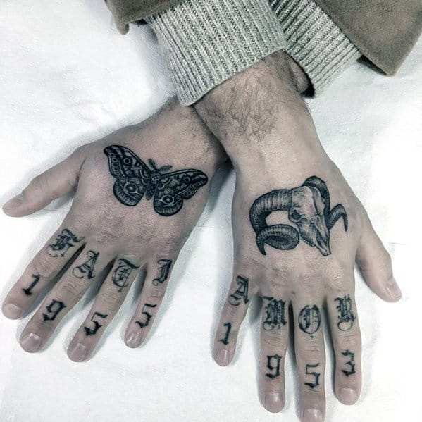 Male Simple Hand Animal Skull With Butterfly Tattoo Ideas