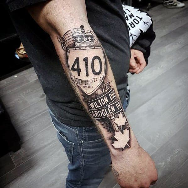 Male Street Sign Themed Tattoos Outer Forearm
