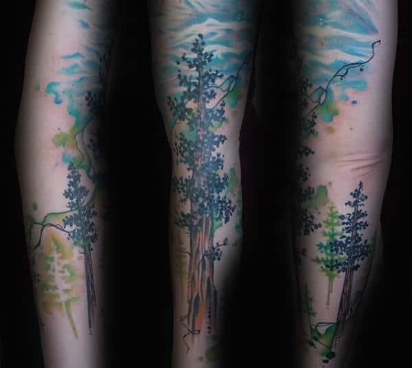 Male Tall Watercolor Tree Tree Tattoo On Forearm