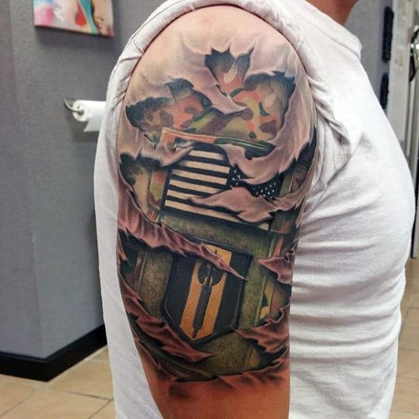 Male Tatto Of Army Badge Patch On Upper Arm Ripped Skin Design
