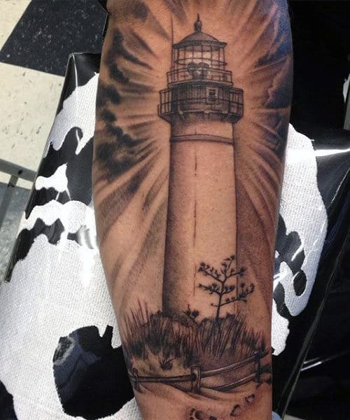 Male Tattoo Of Lighthouse