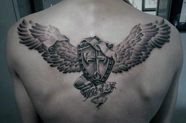 Male Tattoo On Back With Shield And Angel Wings Design