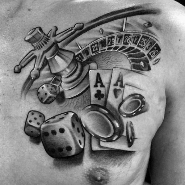 Male Tattoo On Upper Chest With Poker Chip Design