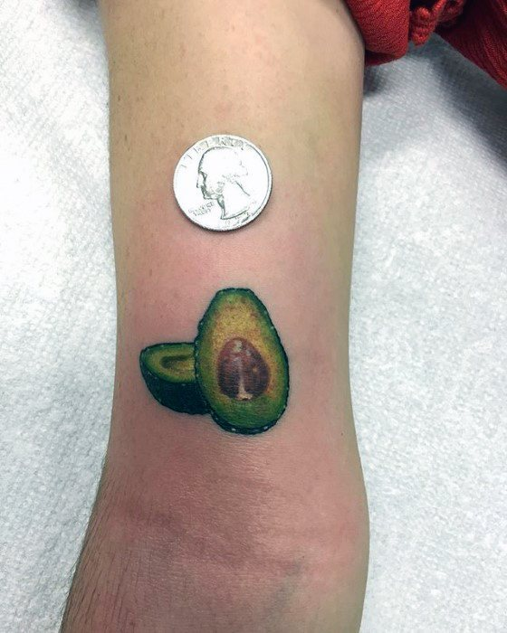 Male Tattoo With Avocado Design