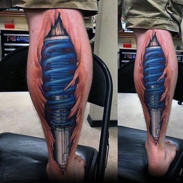 Male Tattoo With Blue Suspension Shock Absorber Design On Back Of Legs
